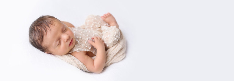 Baby girl white and cream newborn portrait session.