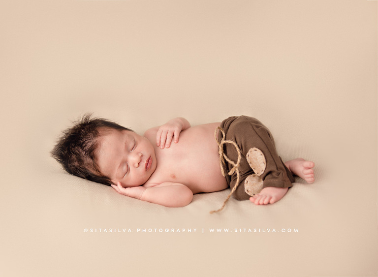 This little one enjoyed listening to classical music he was a charmer and a joy to photograph posted in newborn portraits · paramus new jersey